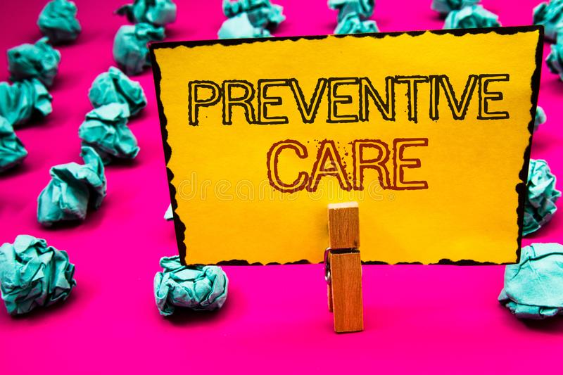 Text sign showing Preventive Care. Conceptual photo Health Prevention Diagnosis Tests Medical Consultation Clothespin hold holding. Yellow paper black red royalty free stock images