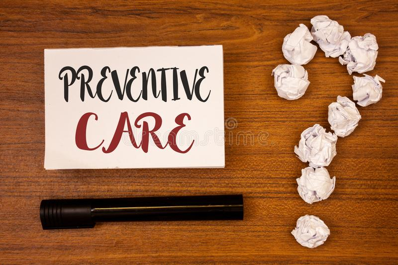 Text sign showing Preventive Care. Conceptual photo Health Prevention Diagnosis Tests Medical Consultation Ideas on paper wooden b. Ackground quotation mark royalty free stock photo