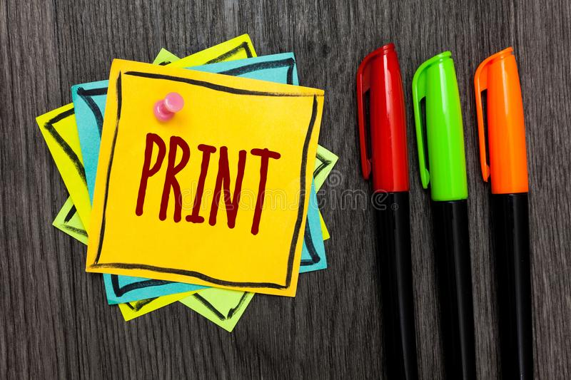 Text sign showing Print. Conceptual photo Produce letter numbers symbols on paper by machine using ink or toner Three marker pens. Four small art papers stock image