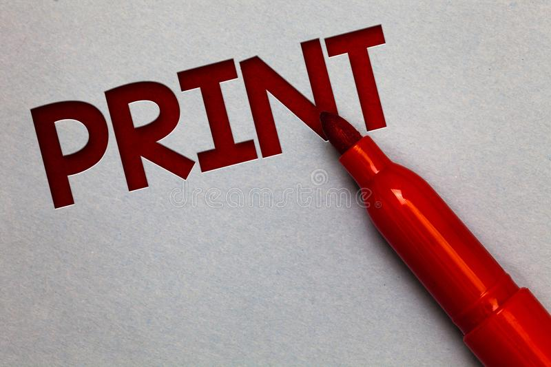 Text sign showing Print. Conceptual photo Produce letter numbers symbols on paper by machine using ink or toner White paper lite g. Rey shadow red marker pen stock photography