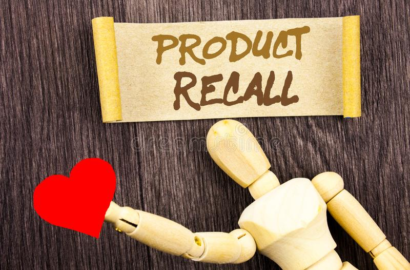 Text sign showing Product Recall. Conceptual photo Recall Refund Return For Products Defects written on Sticky Note Love Heart Hol royalty free stock photo