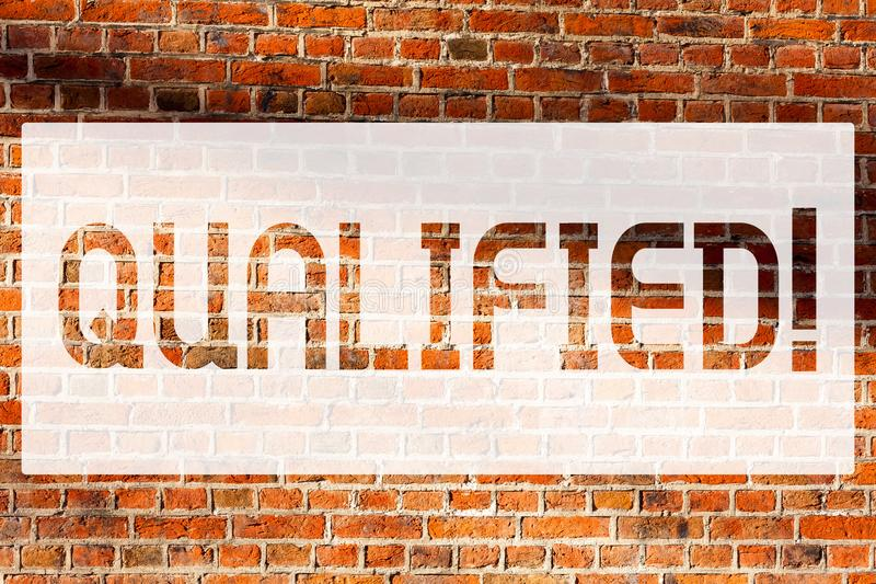 Text sign showing Qualified. Conceptual photo Certified to perform a job Competent Experienced Brick Wall art like Graffiti. Motivational call written on the royalty free stock image