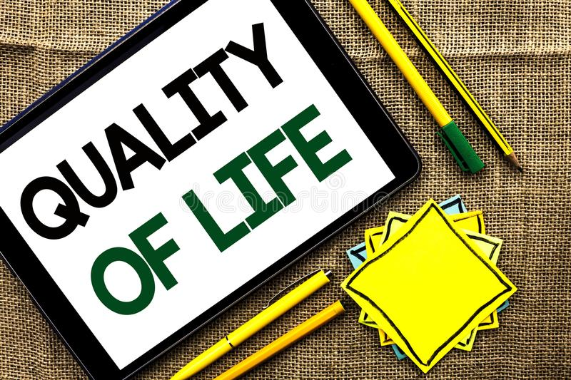 Text sign showing Quality Of Life. Conceptual photo Good Lifestyle Happiness Enjoyable Moments Well-being written on Tablet on the. Text sign showing Quality Of royalty free stock photos