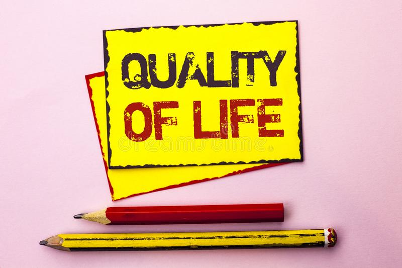 Text sign showing Quality Of Life. Conceptual photo Good Lifestyle Happiness Enjoyable Moments Well-being written on Yellow Sticky. Text sign showing Quality Of stock photo