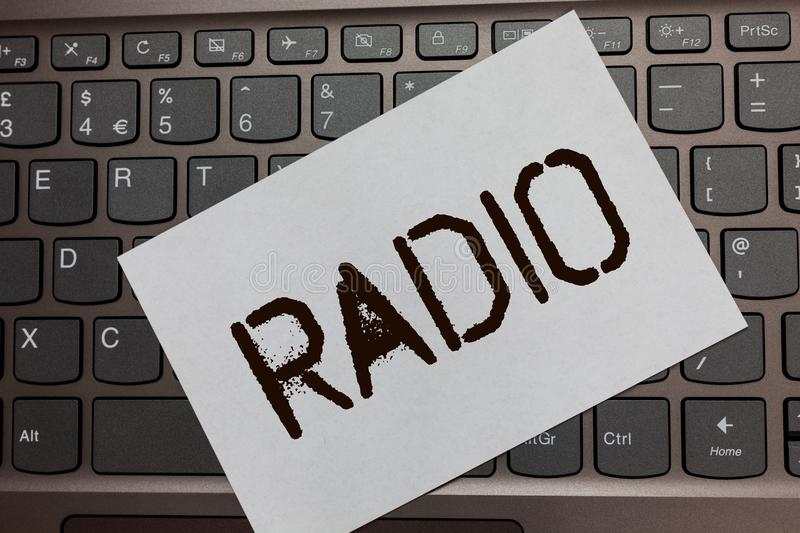Text sign showing Radio. Conceptual photo Electronic equipment used for listening to broadcasts programs shows Black laptop keyboa. Rd art paper nice computer stock photos