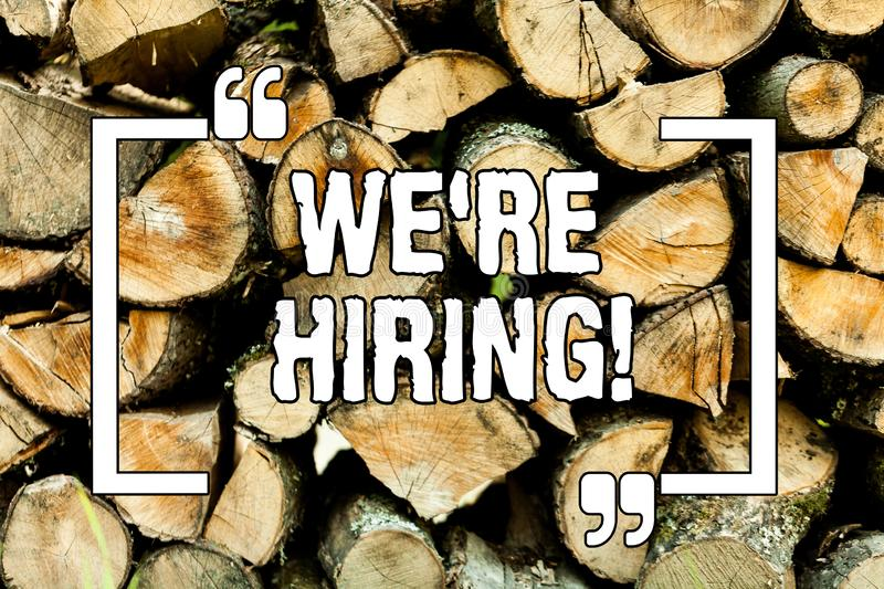 Text sign showing We Re Hiring. Conceptual photo Workforce Wanted New Employees Recruitment Wooden background vintage wood wild. Message ideas intentions stock image