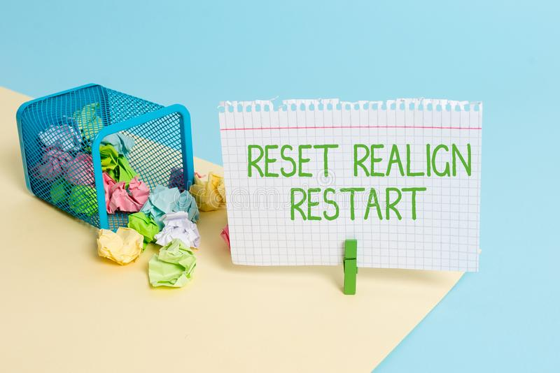 Text sign showing Reset Realign Restart. Conceptual photo Life audit will help you put things in perspectives Trash bin crumpled. Text sign showing Reset Realign stock photo