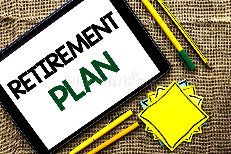 Text sign showing Retirement Plan. Conceptual photo Savings Investments that provide incomes for retired workers written on Tablet. Text sign showing Retirement royalty free stock images