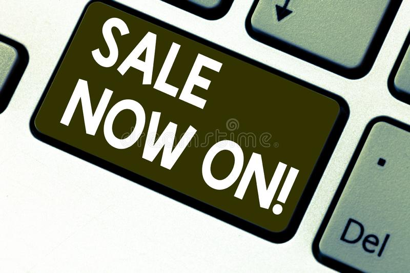 Text sign showing Sale Now On. Conceptual photo Reduction of prices Discounts Special offers at this time Keyboard key. Intention to create computer message stock photos
