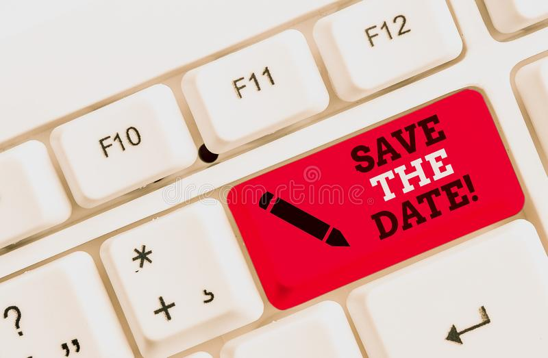 Text sign showing Save The Date. Conceptual photo reserve the mentioned future wedding date on their calendar White pc keyboard. Text sign showing Save The Date stock image