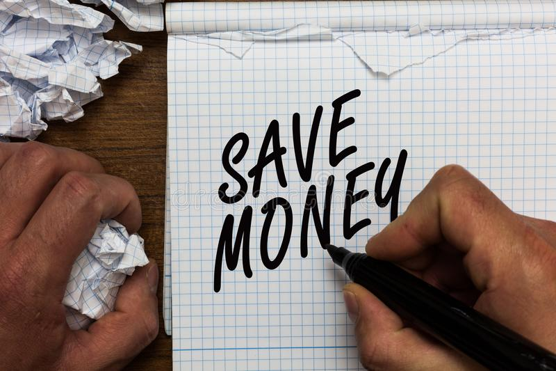 Text sign showing Save Money. Conceptual photo store some of your cash every month to use them sometime later Man holding marker n. Otebook crumpled papers royalty free stock photos