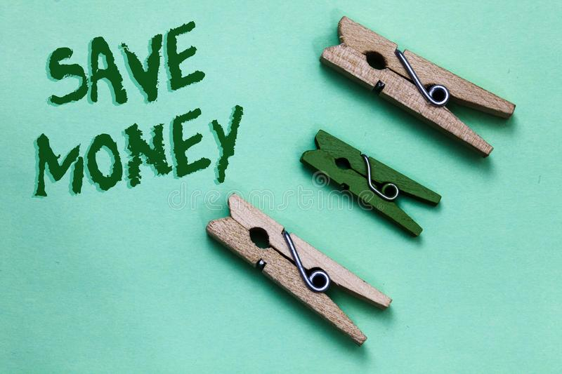 Text sign showing Save Money. Conceptual photo store some of your cash every month to use them sometime later Three brown green vi. Ntage clothespins clear royalty free stock images