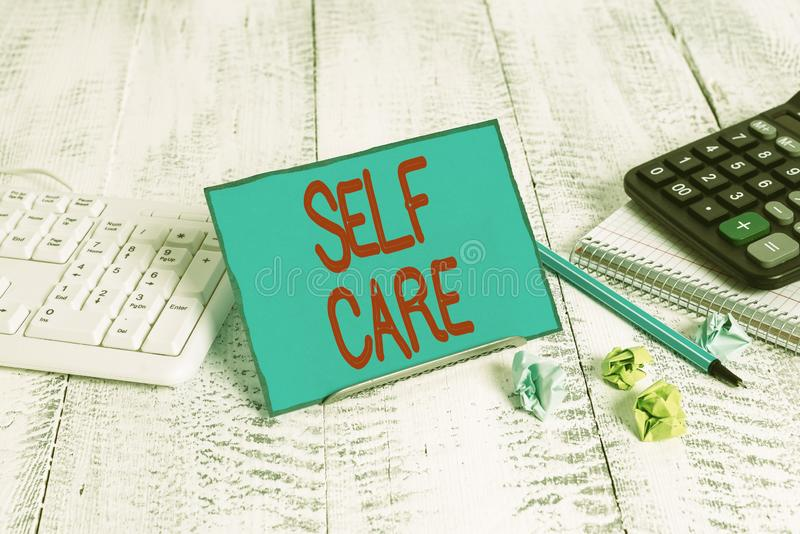 Text sign showing Self Care. Conceptual photo the practice of taking action to improve one s is own health. Text sign showing Self Care. Business photo text the stock image