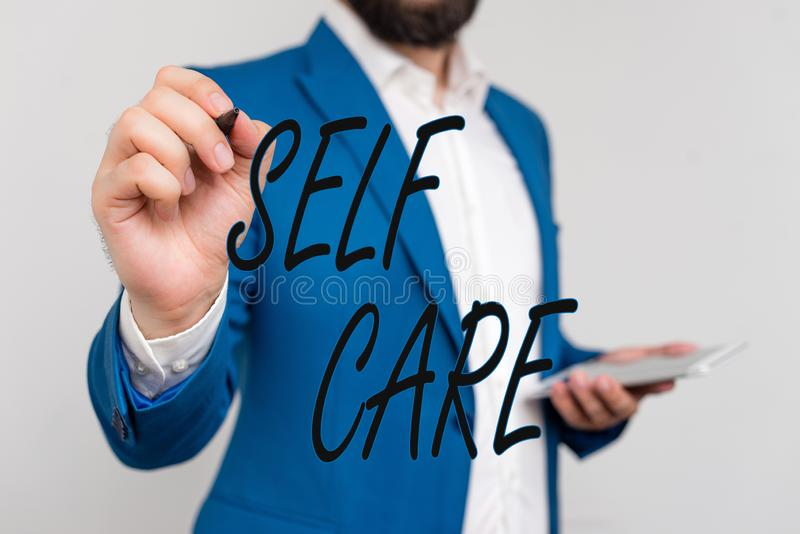 Text sign showing Self Care. Conceptual photo the practice of taking action to improve one s is own health Businessman. Text sign showing Self Care. Business royalty free stock image