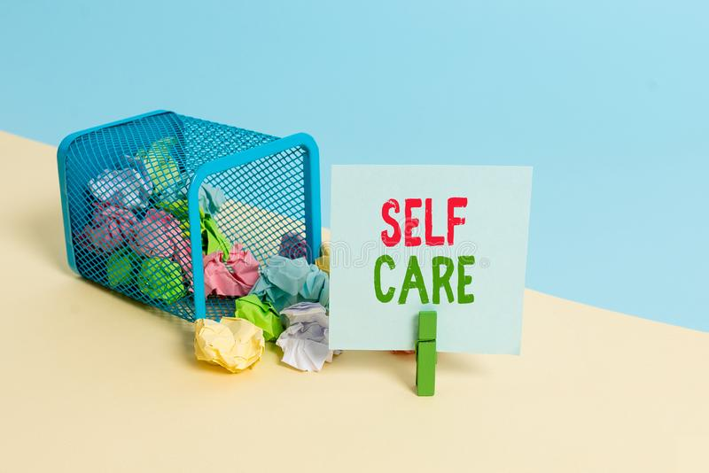 Text sign showing Self Care. Conceptual photo the practice of taking action to improve one s is own health Trash bin. Text sign showing Self Care. Business photo royalty free stock photos