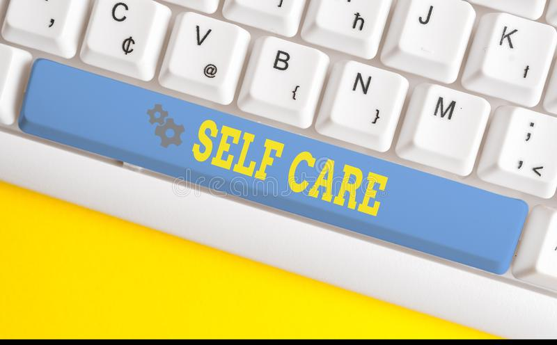 Text sign showing Self Care. Conceptual photo the practice of taking action to improve one s is own health White pc. Text sign showing Self Care. Business photo royalty free stock photos