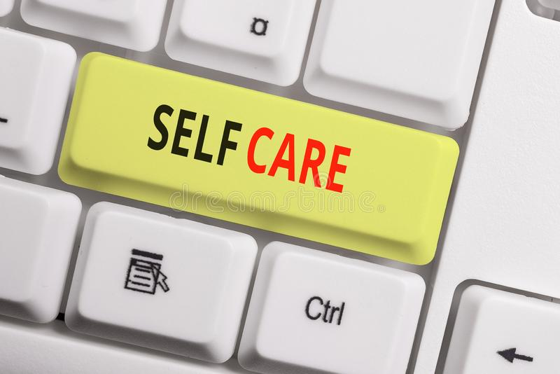 Text sign showing Self Care. Conceptual photo the practice of taking action to improve one s is own health White pc. Text sign showing Self Care. Business photo stock image