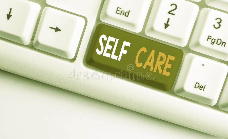 Text sign showing Self Care. Conceptual photo the practice of taking action to improve one s is own health White pc. Text sign showing Self Care. Business photo stock photography