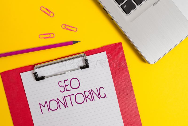 Text sign showing Seo Monitoring. Conceptual photo Tracking the progress of strategy made in the platform Slim metallic. Text sign showing Seo Monitoring royalty free stock image