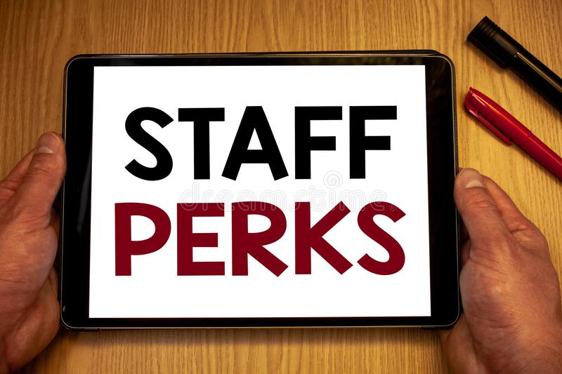 Text sign showing Staff Perks. Conceptual photos Workers Benefits Bonuses Compensation Rewards Health InsuranceMan hold holding ta. Text sign showing Staff Perks royalty free stock photos