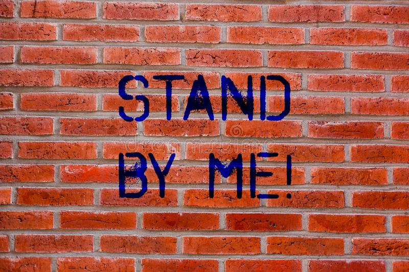 Text sign showing Stand By Me. Conceptual photo Be always around myself there count on someone all the time Brick Wall art like stock image