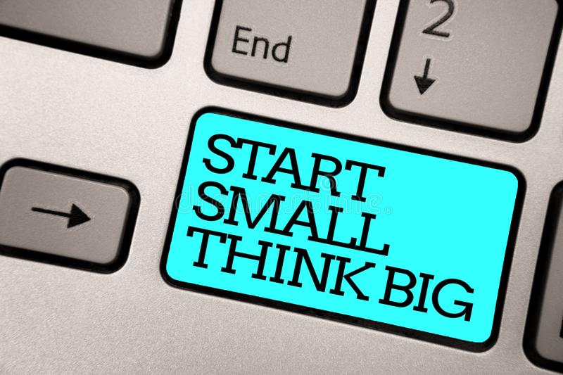 Text sign showing Start Small Think Big. Conceptual photo Initiate with few things have something great in mind Silver grey comput. Er keyboard with blue button royalty free stock images