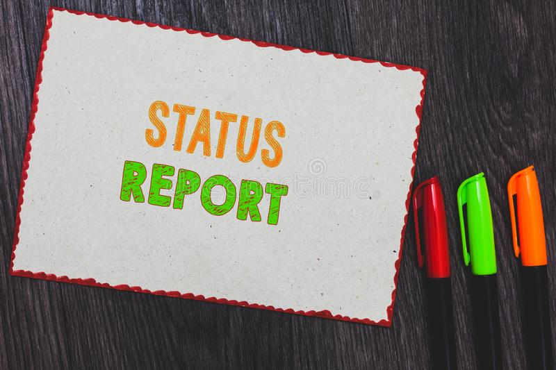 Text sign showing Status Report. Conceptual photo Update Summary of situations as of a period of time White paper red borders colo. Rful markers wooden stock images