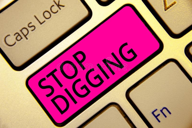 Text sign showing Stop Digging. Conceptual photo Prevent Illegal excavation quarry Environment Conservation Keyboard pink key Inte royalty free stock photos