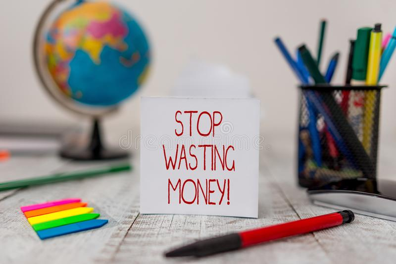 Text sign showing Stop Wasting Money. Conceptual photo advicing demonstrating or group to start saving and use it wisely. Text sign showing Stop Wasting Money stock photography