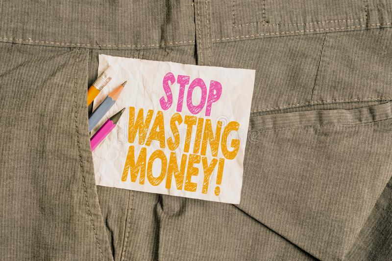 Text sign showing Stop Wasting Money. Conceptual photo advicing demonstrating or group to start saving and use it wisely. Text sign showing Stop Wasting Money stock photos