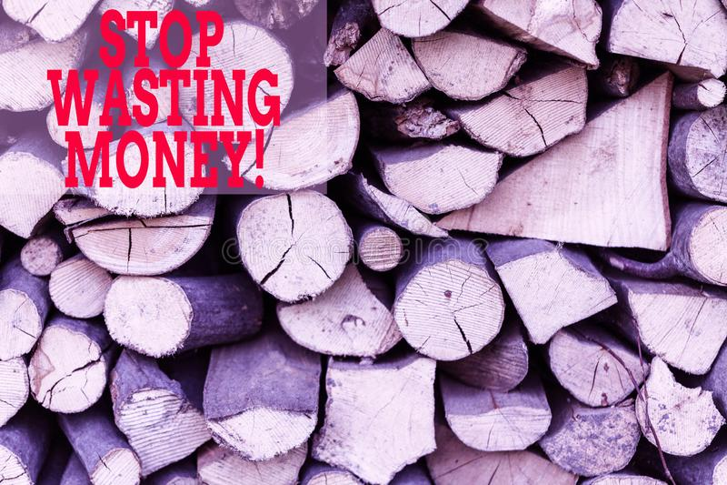 Text sign showing Stop Wasting Money. Conceptual photo advicing demonstrating or group to start saving and use it wisely. Text sign showing Stop Wasting Money royalty free stock images