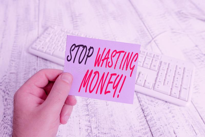Text sign showing Stop Wasting Money. Conceptual photo advicing demonstrating or group to start saving and use it wisely. Text sign showing Stop Wasting Money stock image
