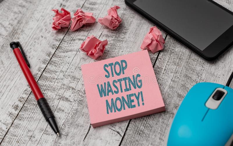 Text sign showing Stop Wasting Money. Conceptual photo advicing demonstrating or group to start saving and use it wisely. Text sign showing Stop Wasting Money royalty free stock photos
