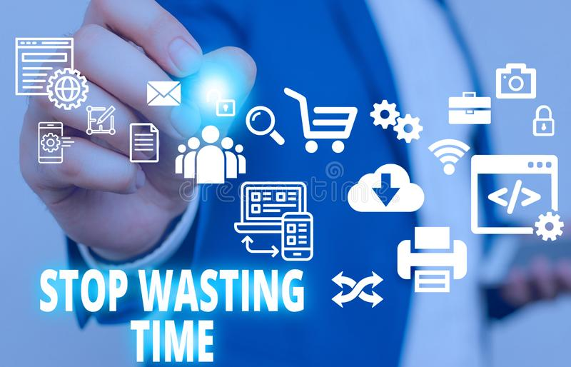 Text sign showing Stop Wasting Time. Conceptual photo advising demonstrating or group start planning and use it Male. Text sign showing Stop Wasting Time stock photo