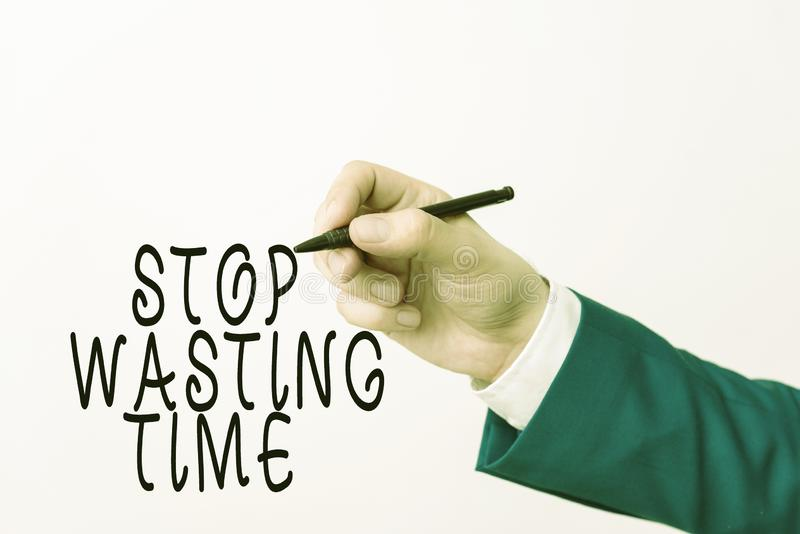 Text sign showing Stop Wasting Time. Conceptual photo advising demonstrating or group start planning and use it wisely. Text sign showing Stop Wasting Time stock images