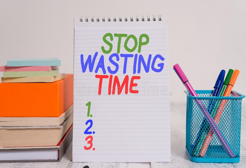 Text sign showing Stop Wasting Time. Conceptual photo advising demonstrating or group start planning and use it wisely. Text sign showing Stop Wasting Time royalty free stock photo