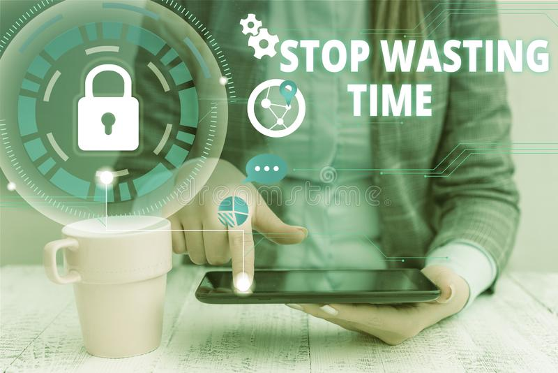 Text sign showing Stop Wasting Time. Conceptual photo advising demonstrating or group start planning and use it woman. Text sign showing Stop Wasting Time royalty free stock photos