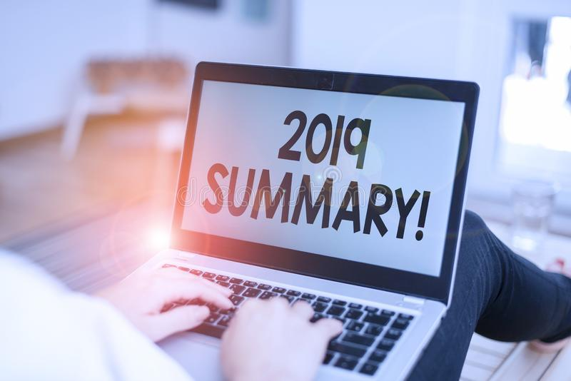Text sign showing 2019 Summary. Conceptual photo summarizing past year events main actions or good shows woman laptop computer. Text sign showing 2019 Summary stock photos