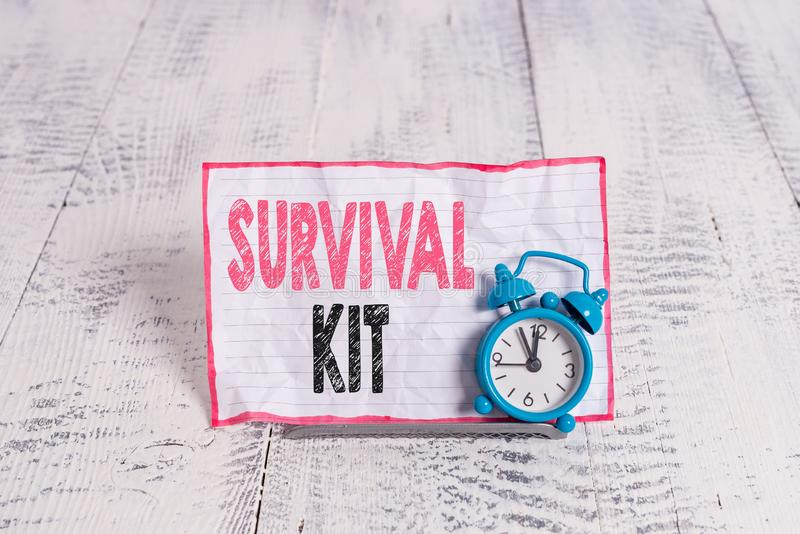 Text sign showing Survival Kit. Conceptual photo Emergency Equipment Collection of items to help someone. Text sign showing Survival Kit. Business photo text royalty free stock photo