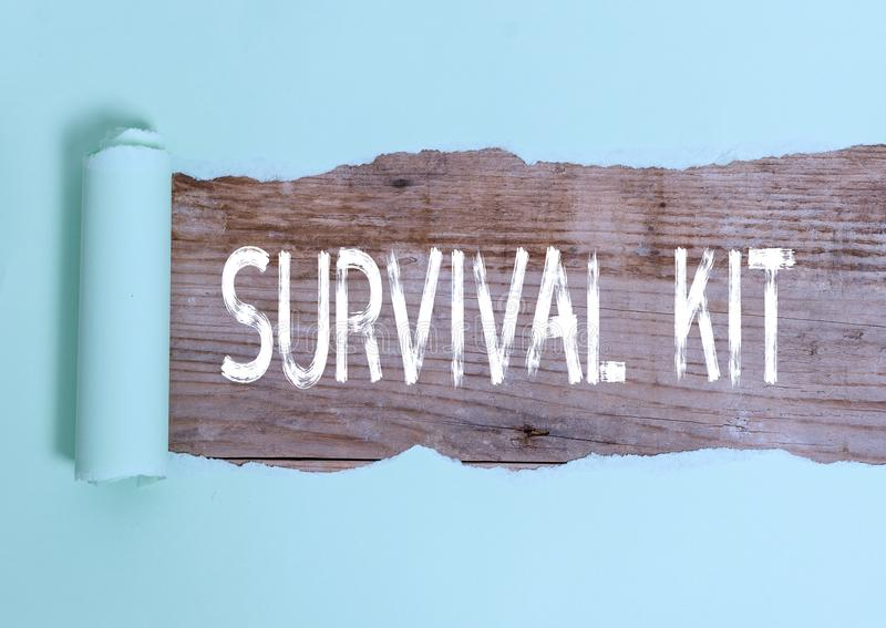 Text sign showing Survival Kit. Conceptual photo Emergency Equipment Collection of items to help someone. Text sign showing Survival Kit. Business photo text stock photos