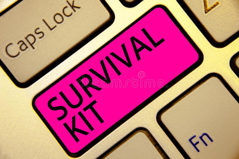 Text sign showing Survival Kit. Conceptual photo Emergency Equipment Collection of items to help someone Keyboard pink key Intenti. On create computer computing royalty free stock photo