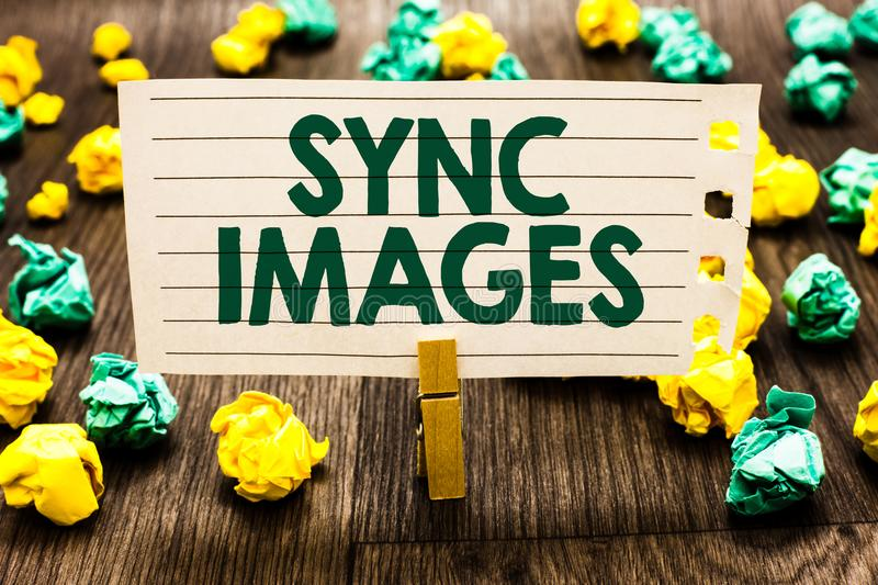 Text sign showing Sync Images. Conceptual photo Making photos identical in all devices Accessible anywhere Clothespin holding note. Book paper crumpled papers royalty free stock photography