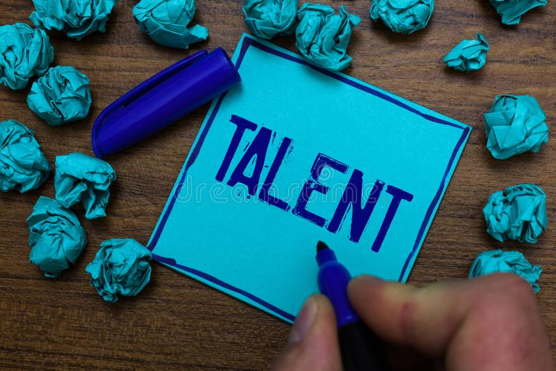 Text sign showing Talent. Conceptual photo Natural abilities of people showing specialized skills they possess Cyan paper object t. Houghts crumpled papers ideas stock photo