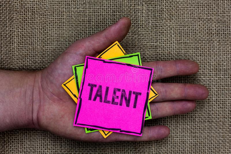 Text sign showing Talent. Conceptual photo Natural abilities of people showing specialized skills they possess Holding small pitch. Es art papers thoughts ideas stock images
