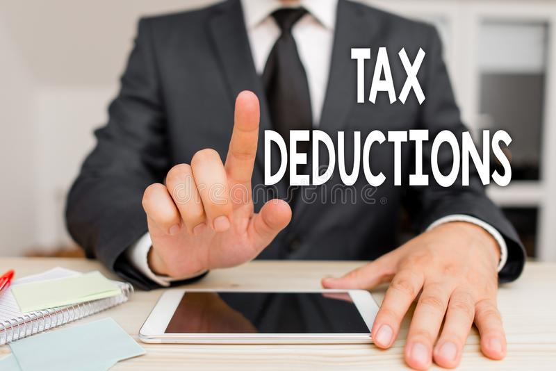 Text sign showing Tax Deductions. Conceptual photo an amount or cost that subtracted from someone s is income. Text sign showing Tax Deductions. Business photo royalty free stock photo