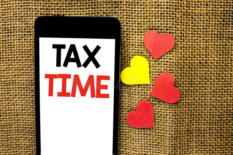 Text sign showing Tax Time. Conceptual photo Taxation Deadline Finance Pay Accounting Payment Income Revenue written on Cardboard. Text sign showing Tax Time stock photos