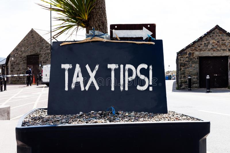 Text sign showing Tax Tips. Conceptual photo compulsory contribution to state revenue levied by government Empty black. Text sign showing Tax Tips. Business royalty free stock image
