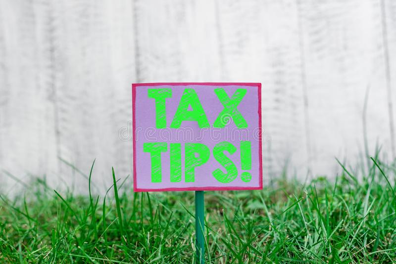 Text sign showing Tax Tips. Conceptual photo compulsory contribution to state revenue levied by government Plain empty. Text sign showing Tax Tips. Business stock photography