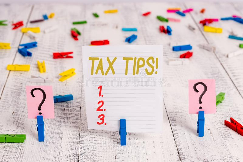 Text sign showing Tax Tips. Conceptual photo compulsory contribution to state revenue levied by government Scribbled and. Text sign showing Tax Tips. Business stock photo