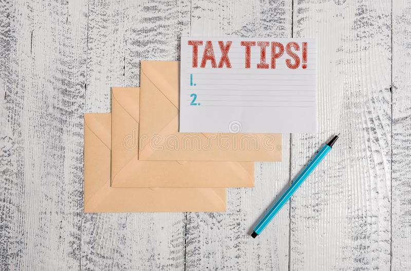 Text sign showing Tax Tips. Conceptual photo compulsory contribution to state revenue levied by government Three. Text sign showing Tax Tips. Business photo stock photo